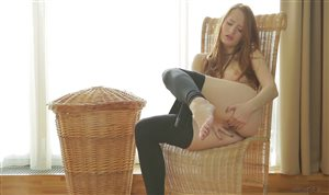Denisa Heaven fingers her pussy on the chair