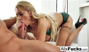 Alix Lynx is enjoying with a rod in her mouth