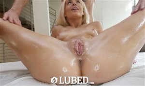 Blonde covered in oil gets fucked