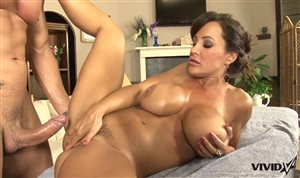 Lisa Ann getting her huge tits massage with a hot oil