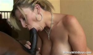Busty blonde MILF blows and fucks a BBC on the couch